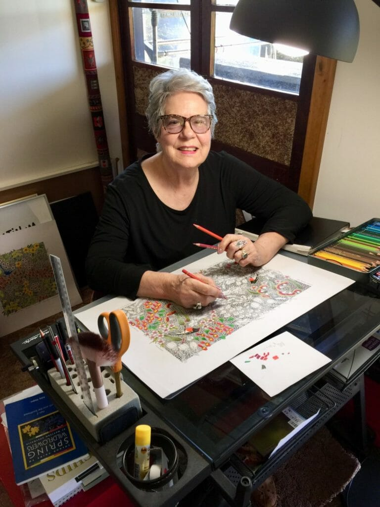 Hilde Ranson illustrating at her drawing desk